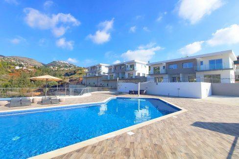 Immobilie zum Kauf auf Zypern: Neubau-Doppelhaushälften mit Meerblick und Pool in Tala - PFSB228